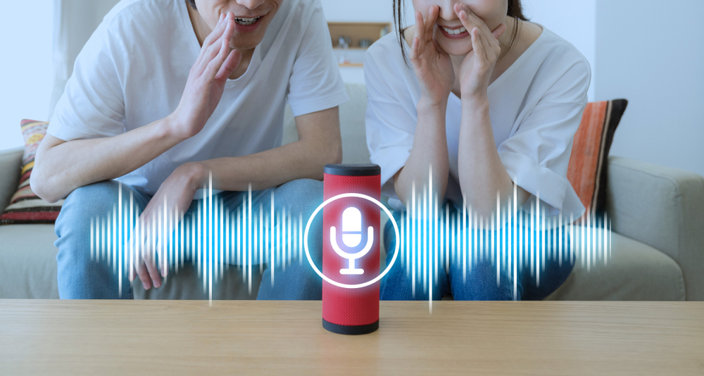 2 people using AI voice recognition with a virtual assistant.