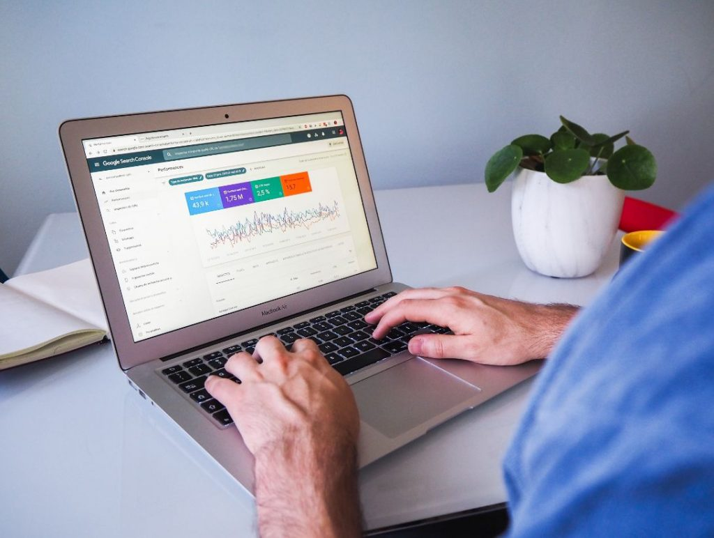 Person typing on a laptop and looking at data in Google Search Console