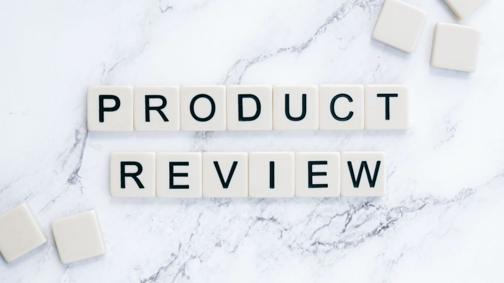 """Product Review"" in scrabble letters.Photo by Shotkit from Pexels."